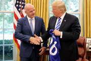 U.S. President Donald Trump (R) and FIFA President Gianni Infantino shake hands after posing for photographs in the Oval Office at the White House August 28, 2018 in Washington, DC. The 2026 FIFA World Cup will be jointly hosted by the United States, Canada and Mexico and will be the first World Cup in history to be held in three countries at the same time.