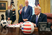 U.S. President Donald Trump (R) makes brief remarks to reporters during a meeting with U.S. Soccer President Carlos Cordeiro (C) and FIFA President Gianni Infantino (2nd L) in the Oval Office at the White House August 28, 2018 in Washington, DC. The 2026 FIFA World Cup will be jointly hosted by the United States, Canada and Mexico and will be the first World Cup in history to be held in three countries at the same time.