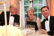 US President Donald Trump with British Prime Minister Theresa May and British Foreign Secretary Jeremy Hunt.at a dinner hosted by himself and First Lady Melania Trump at Winfield House for Prince Charles, Prince of Wales and Camilla, Duchess of Cornwall, during their state visit on June 04, 2019 in London, England. President Trump's three-day state visit began with lunch with the Queen, followed by a State Banquet at Buckingham Palace, whilst today he attended business meetings with the Prime Minister and the Duke of York, before traveling to Portsmouth to mark the 75th anniversary of the D-Day landings.