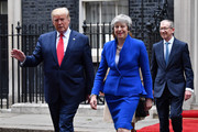 Prime Minister Theresa May and US President Donald Trump leave 10 Downing Street, during the second day of his State Visit on June 4, 2019 in London, England. President Trump's three-day state visit began with lunch with the Queen, followed by a State Banquet at Buckingham Palace, whilst today he will attend business meetings with the Prime Minister and the Duke of York, before travelling to Portsmouth to mark the 75th anniversary of the D-Day landings.