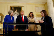 Prime Minister Theresa May, husband Philip May, US President Donald Trump and First Lady Melania Trump view items during a visit to 10 Downing Street, during the second day of the president's State Visit on June 4, 2019 in London, England. President Trump's three-day state visit began with lunch with the Queen, followed by a State Banquet at Buckingham Palace, whilst today he will attend business meetings with the Prime Minister and the Duke of York, before travelling to Portsmouth to mark the 75th anniversary of the D-Day landings.