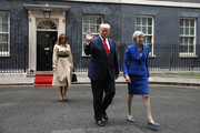 Melania Trump, US President Donald Trump and Prime Minister Theresa May leave 10 Downing Street for the Foreign and Commonwealth Office during the second day of his State Visit on June 4, 2019 in London, England.. President Trump's three-day state visit began with lunch with the Queen, followed by a State Banquet at Buckingham Palace, whilst today he will attend business meetings with the Prime Minister and the Duke of York, before travelling to Portsmouth to mark the 75th anniversary of the D-Day landings.