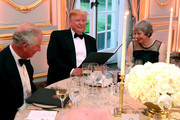 US President Donald Trump and British Prime Minister Theresa May smile at a dinner hosted by himself and First Lady Melania Trump at Winfield House for Prince Charles, Prince of Wales (L) and Camilla, Duchess of Cornwall, during their state visit on June 04, 2019 in London, England. President Trump's three-day state visit began with lunch with the Queen, followed by a State Banquet at Buckingham Palace, whilst today he attended business meetings with the Prime Minister and the Duke of York, before traveling to Portsmouth to mark the 75th anniversary of the D-Day landings.