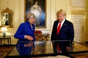Prime Minister Theresa May and US President Donald Trump view items during a visit to 10 Downing Street, during the second day of his State Visit on June 4, 2019 in London, England. President Trump's three-day state visit began with lunch with the Queen, followed by a State Banquet at Buckingham Palace, whilst today he will attend business meetings with the Prime Minister and the Duke of York, before travelling to Portsmouth to mark the 75th anniversary of the D-Day landings.