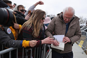 Democratic presidential candidate Sen. Bernie Sanders (I-VT) signs a book for a supporters a the conclusion of a campaign rally in the Central Mall of the Utah State Fair Park March 02, 2020 in Salt Lake City, Utah. Sanders is campaigning in Utah and Minnesota the day before Super Tuesday, when 1,357 Democratic delegates in 14 states across the country will be up for grabs.
