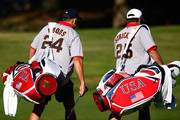 Caddies Steve Williams, (L) and Jimmy Johnson walk up a fairway during a practice round prior to the start of The Presidents Cup at Harding Park Golf Course on October 7, 2009 in San Francisco, California.