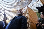 "Chinese activist and artist Ai Weiwei stands in one of his new art installations in Central Park, part of a series of works entitled ""Good Fences Make Good Neighbors"" on October 10, 2017 in New York City. Covering over 300 sites in New York City,  ""Good Fences Make Good Neighbors"" seeks to highlight and start a discussion on the global refugee crisis. The works can be viewed through February 11 in a variety of locations including city parks, bus shelters, newsstands and rooftops."