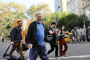 "Chinese activist and artist Ai Weiwei walks in front of one of his new art installations in Central Park, part of a series of works entitled ""Good Fences Make Good Neighbors"" on October 10, 2017 in New York City. Covering over 300 sites in New York City,  ""Good Fences Make Good Neighbors"" seeks to highlight and start a discussion on the global refugee crisis. The works can be viewed through February 11 in a variety of locations including city parks, bus shelters, newsstands and rooftops."