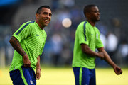 Carlos Tevez (L) of Juventus smiles with Patrice Evra during a Juventus training session on the eve of the UEFA Champions League Final match against FC Barcelona at Olympiastadion on June 5, 2015 in Berlin, Germany.
