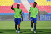 Patrice Evra (L) of Juventus talks to team mate Kingsley Coman during a Juventus training session on the eve of the UEFA Champions League Final match against FC Barcelona at Olympiastadion on June 5, 2015 in Berlin, Germany.