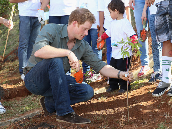 Prince Harry plants a tree as he visits Cota Dos Ventos, a small village in the Brazilian Atlantic Rainforest on June 25, 2014 in Cota Dos Ventos, Brazil.  Prince Harry is on a four day tour of Brazil that will be followed by Two days in Chile.