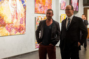 (EXCLUSIVE COVERAGE) Prince Albert II of Monaco and artist Mark McFadden attend an exhibition by Mark McFadden at HVMC Hotel des Ventes de Monte Carlo on May 15, 2013 in Monaco, Monaco.