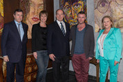 Prince Albert II of Monaco poses with the owners of the gallery Franck Baille (L) and Chantal Beauvois (R) the artist Mark McFadden (2R) and Sabine Ferber (2L) at an exhibition by Mark McFadden at HVMC Hotel des Ventes de Monte Carlo on May 15, 2013 in Monaco, Monaco.