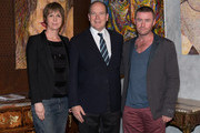 Prince Albert II of Monaco poses with the artist Mark McFadden and Sabine Ferber at an exhibition by Mark McFadden at HVMC Hotel des Ventes de Monte Carlo on May 15, 2013 in Monaco, Monaco.