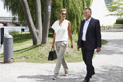 Franziska van Almsick and Juergen B. Harder arrive for a boat tour with the Monaco royal couple on the Spree canal on July 9, 2012 in Berlin, Germany. Prince Albert II and Princess Charlene of Monaco are visiting Berlin and tomorrow will continue to Stuttgart.