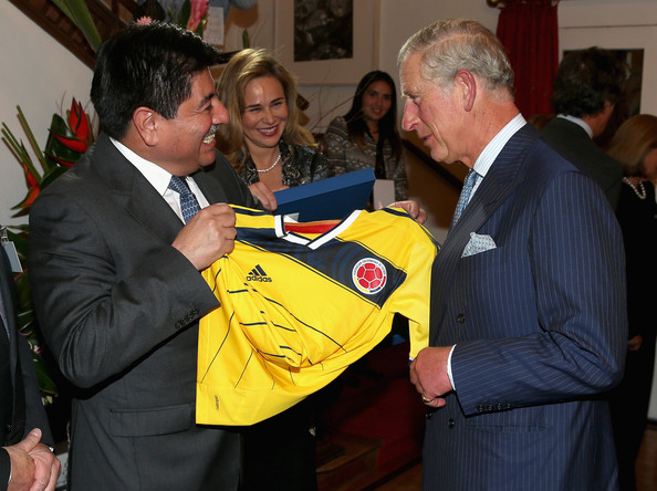 Prince Charles, Prince of Wales is presented with a Colombian Football shirt during a reception at the Ambassador's Residence on October 28, 2014 in Bogota, Colombia. The Royal Couple are on a four day visit to Colombia as part of a Royal tour to Colombia and Mexico. After fifty years of armed conflict in Colombia the theme for the visit is Peace and Reconciliation.