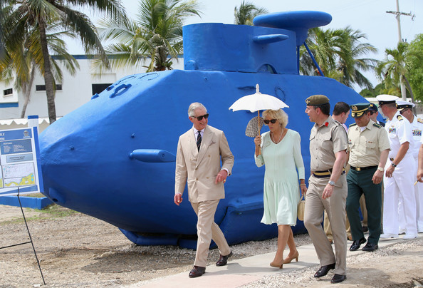 Camilla, Duchess of Cornwall and Prince Charles, Prince of Wales walk past a 'homemade' fibreglass drug smuggling submarine used to smuggle up to 2 tonnes of Cocaine as they visit the CoastGuard on October 31, 2014 in Cartagena, Colombia. The Royal Couple are on a four day visit to Colombia as part of a Royal tour to Colombia and Mexico. After fifty years of armed conflict in Colombia the theme for the visit is Peace and Reconciliation.