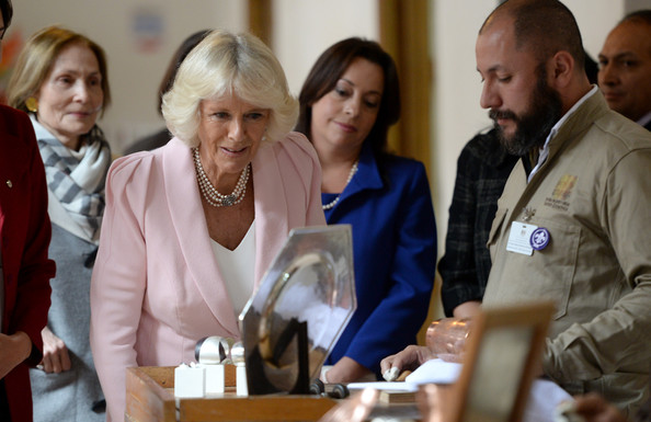 Camilla, Duchess of Cornwall views a metal engraving workshop during a visit to Escuela de Artes Y Oficios Arts and Crafts School on October 29, 2014 in Bogota, Colombia. The Royal Couple are on a four day visit to Colombia as part of a Royal tour to Colombia and Mexico. After fifty years of armed conflict in Colombia the theme for the visit is Peace and Reconciliation.