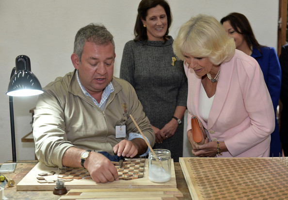 Camilla, Duchess of Cornwall views a wood engraving workshop during a visit to Escuela de Artes Y Oficios Arts and Crafts School on October 29, 2014 in Bogota, Colombia. The Royal Couple are on a four day visit to Colombia as part of a Royal tour to Colombia and Mexico. After fifty years of armed conflict in Colombia the theme for the visit is Peace and Reconciliation.