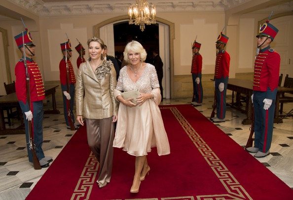 Camilla, Duchess of Cornwall walks down the red carpet with the First Lady of Colombia María Clemencia Rodríguez Múnera as they attend a State Dinner at the Presidential Palace for an Official Welcome on October 29, 2014 in Bogota, Colombia. The Royal Couple are on a four day visit to Colombia as part of a Royal tour to Colombia and Mexico. After fifty years of armed conflict in Colombia the theme for the visit is Peace and Reconciliation.