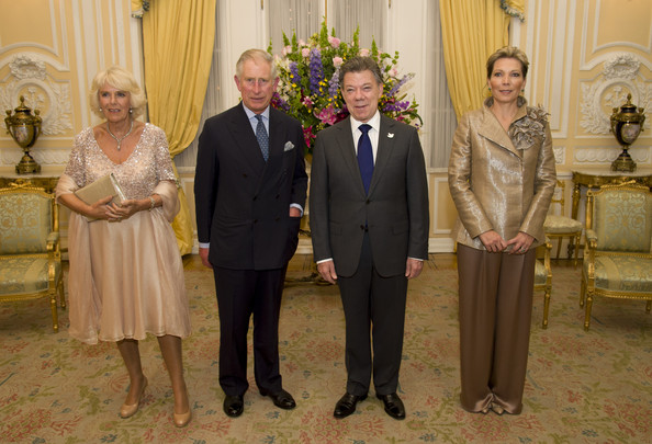 Camilla, Duchess of Cornwall poses with Prince Charles, Prince of Wales the First Lady of Colombia María Clemencia Rodríguez Múnera and the President of Colombia Juan Manuel Santos at the Presidential Palace for a State Dinner on October 29, 2014 in Bogota, Colombia. The Royal Couple are on a four day visit to Colombia as part of a Royal tour to Colombia and Mexico. After fifty years of armed conflict in Colombia the theme for the visit is Peace and Reconciliation.