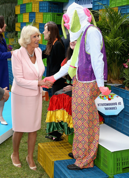 Camilla, Duchess of Cornwall meets a Carnival performer at a Sustainability Fair at the Ambassador's Residence on October 29, 2014 in Bogota, Colombia. The Royal Couple are on a four day visit to Colombia as part of a Royal tour to Colombia and Mexico. After fifty years of armed conflict in Colombia the theme for the visit is Peace and Reconciliation.