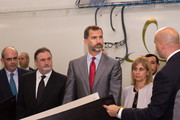 Prince Felipe of Spain with  Carbures Europe President Carlos Guillen and Mayor of Jerez Maria Jose Garcia-Pelayo, listening to Javier Moreno during quality controls at Carbures Europe, a manufacturer specialized in carbon structures technologies for airplanes, on October 28, 2013 in Jerez de la Frontera, Spain.
