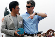 Prince Frederik of Denmark presents the People's Choice Prize to South Korean artist Byeong Doo Moon (L) at the Sculpture by the Sea on November 20, 2011 in Sydney, Australia. Princess Mary and Prince Frederik are on their first official visit to Australia since 2008. The Royal visit begins in Sydney, before heading to Melbourne, Canberra and Broken Hill.