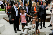 Prince Frederik of Denmark (2nd R) watches as young children try the Archimedes Screw water pump at the Darling Quarter water playground on November 21, 2011 in Sydney, Australia. Princess Mary and Prince Frederik are on their first official visit to Australia since 2008. The Royal visit begins in Sydney, before heading to Melbourne, Canberra and Broken Hill.