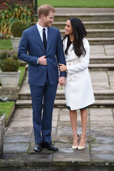 Announcement of Prince Harry's Engagement to Meghan Markle [suit,photograph,formal wear,groom,standing,tuxedo,dress,event,outerwear,harry,meghan markle,engagement,engagement,the sunken gardens,kensington palace,england,london,announcement,photocall]