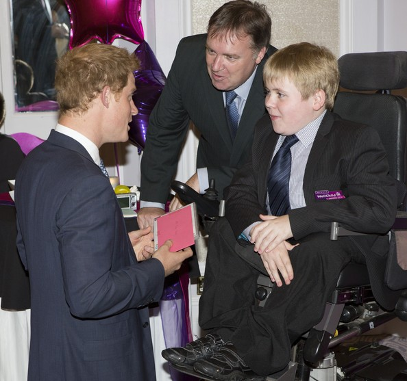 Prince Harry Prince Harry meets Martin Bennett (14) , Inspirational young person award winner 12-13, who presented him with a kids DVD for Prince George, during the WellChild awards at the London Hilton on September 22, 2014 in London, England.
