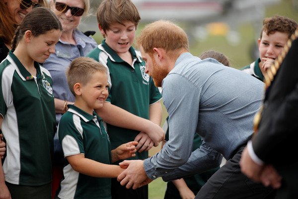 The Duke And Duchess Of Sussex Visit Australia - Day 2 [youth,team,event,coach,team sport,crowd,competition event,gesture,player,harry,children,australia,dubbo airport,cities,duchess,duke of sussex,duke and duchess of sussex visit,autumn,tour]