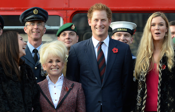 Prince Harry Prince Harry (2nd-R) poses for a photo with supporters of the Royal British Legion's London Poppy Day appeal with Joss Stone (R), Barbara Windsor (2nd-L) and Lacey Turner (L) before getting on board the poppy bus at Buckingham Palace on October 30, 2014 in London, England. The 1960s Routemaster bus today is carrying war veterans and celebrity supporters including Joss Stone and Barbara Windsor around London and will later meet the Prime Minister David Cameron.