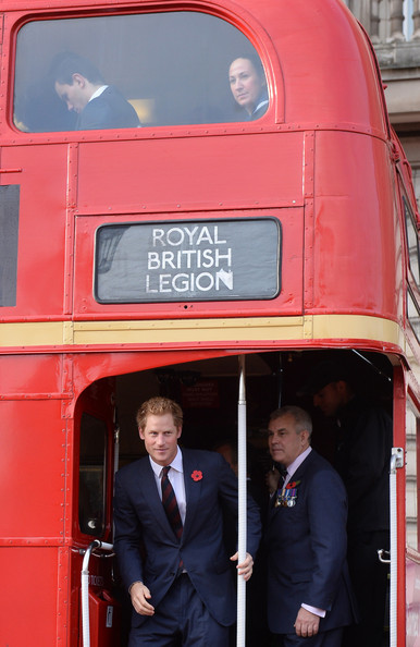 Prince Harry Prince Harry stand aboard the poppy bus after meeting supporters of the Royal British Legion's London Poppy Day appeal at Buckingham Palace on October 30, 2014 in London, England. The 1960s Routemaster bus today is carrying war veterans and celebrity supporters including Joss Stone and Barbara Windsor around London and will later meet the Prime Minister David Cameron.