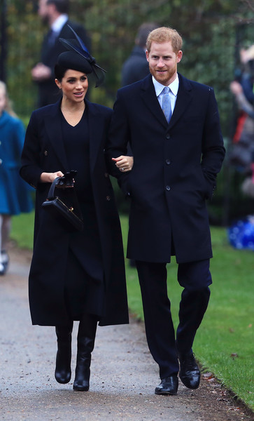 The Royal Family Attend Church On Christmas Day [the royal family attend church on christmas day,suit,coat,fashion,outerwear,standing,academic dress,formal wear,gentleman,tuxedo,girl,harry,meghan markle,service,sussex,duchess,estate,church of st mary magdalene,christmas day church,wedding,meghan duchess of sussex,prince harry,wedding of prince harry and meghan markle,british royal family,united kingdom,house of windsor,christmas day,catherine duchess of cambridge]