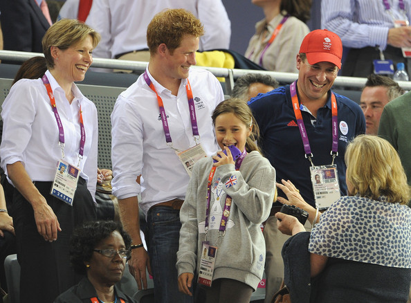Prince Harry A young girl, who had her picture taken with Prince Harry and LOCOG Chair Lord Sebastian Coe smiles as Carole Coe (L) and Peter Phillips (R) look on during the Track Cycling on Day 11 of the London 2012 Olympic Games at the Velodrome on August 7, 2012 in London, England.