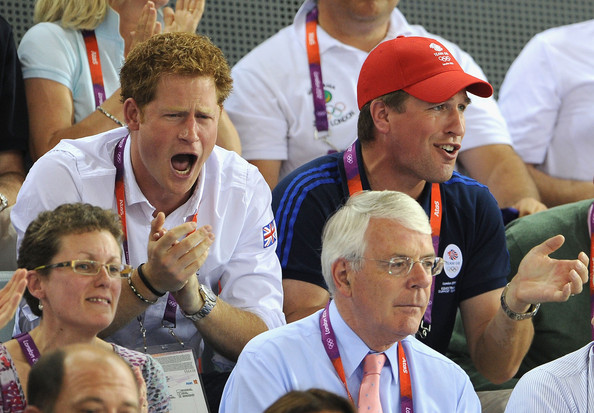 Prince Harry Prince Harry, Peter Phillips and former Prime Minister John Major (front) enjoy the atmosphere as they watch the Track Cycling on Day 11 of the London 2012 Olympic Games at the Velodrome on August 7, 2012 in London, England.