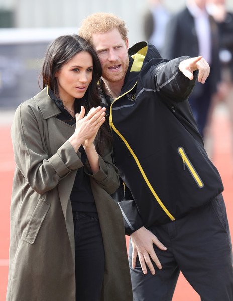 Prince Harry And Meghan Markle Attend UK Team Trials For The Invictus Games Sydney 2018 [meghan markle attend uk team trials for the invictus games,academic dress,gesture,outerwear,hug,graduation,photography,smile,harry,meghan markle,sports,bath,nations,university of bath sports training village,invictus games foundation,invictus games,uk team trials]