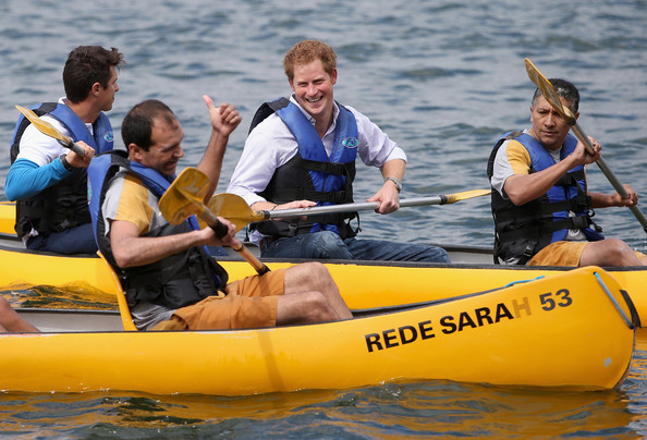 Prince Harry shares a joke with a patient from the Rede Sarah Hospital for Nerological Rehabilitation injuries as he takes part in a canoe therapy session on Lake Paranoa on June 23, 2014 in Brasilia, Brazil. Prince Harry is on a four day tour in Brazil that will be followed by two days in Chile.