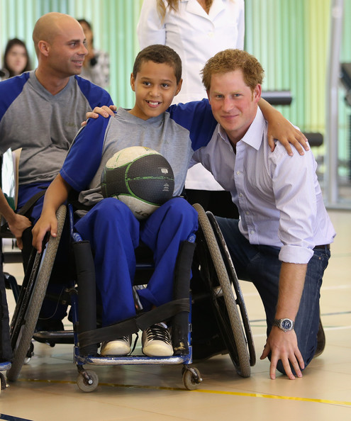 Prince Harry poses with Patient Caio Carvalho, aged 11,  from the Rede Sarah Hospital for Nerological Rehabilitation injuries as he visits the Rede Sarah Hospital on June 23, 2014 in Brasilia, Brazil.  Prince Harry is on a four day tour in Brazil that will be followed by two days in Chile.