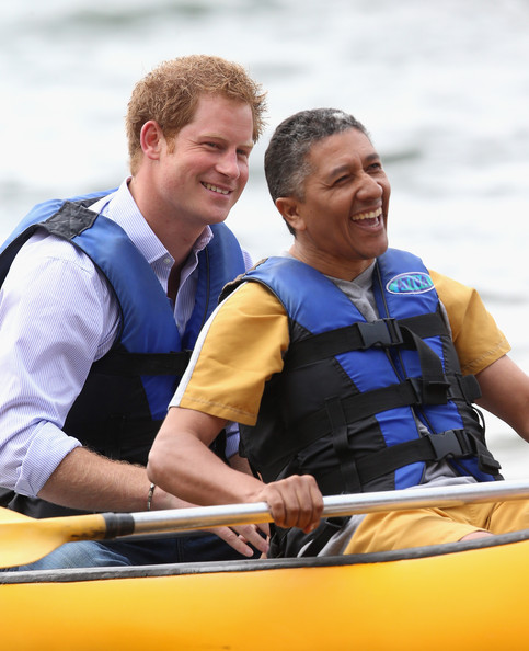 Prince Harry shares a joke with patient Israel Lima from the Rede Sarah Hospital for Nerological Rehabilitation injuries as he takes part in a canoe therapy session on Lake Paranoa on June 23, 2014 in Brasilia, Brazil. Prince Harry is on a four day tour in Brazil that will be followed by two days in Chile.