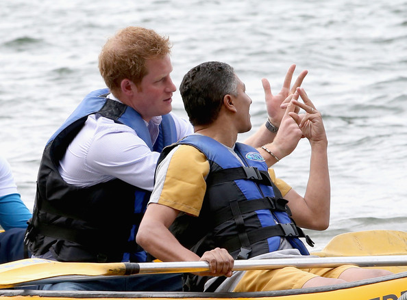 Prince Harry canoes with patient Israel Lima from the Rede Sarah Hospital for Nerological Rehabilitation injuries as he takes part in a canoe therapy session on Lake Paranoa on June 23, 2014 in Brasilia, Brazil.  Prince Harry is on a four day tour of Brazil that will be followed by Two days in Chile.