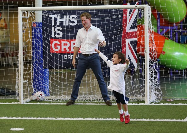 A young boy celebrates after scoring a goal against Prince Harry during a visit to Minas Tenis Clube on the second day of his tour of Brazil on June 24, 2014 in Belo Horizonte, Brazil. Prince Harry is on a four day tour of Brazil that will be followed by two days in Chile.