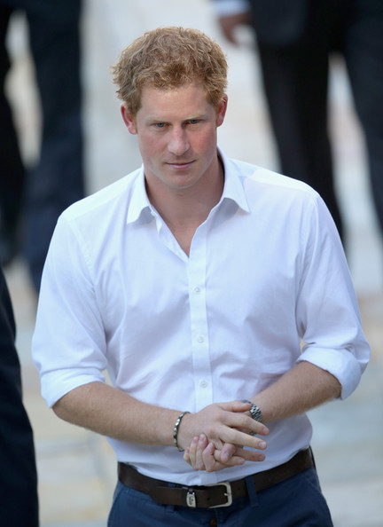 Prince Harry looks on during his visit to Minas Tenis Clube supporting the UK's GREAT Campaign on June 24, 2014 in Belo Horizonte, Brazil.  Prince Harry is on a four day tour of Brazil that will be followed by Two days in Chile.