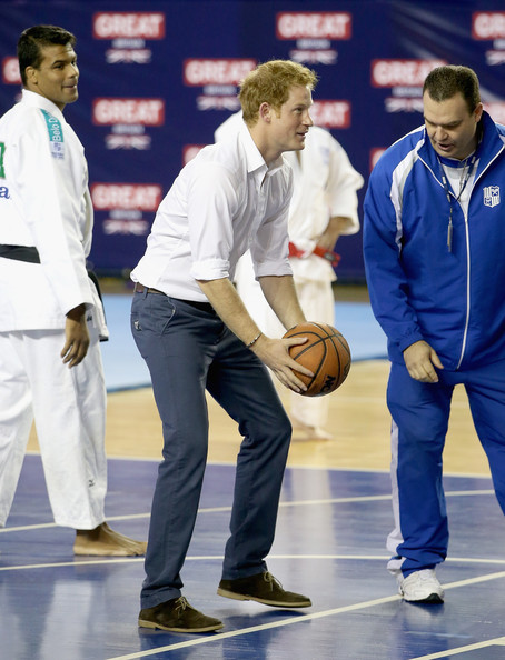 Prince Harry plays basketball in the gym during a visit to Minas Tenis Clube supporting the UK's GREAT Campaign on June 24, 2014 in Belo Horizonte, Brazil.  Prince Harry is on a four day tour of Brazil that will be followed by Two days in Chile.