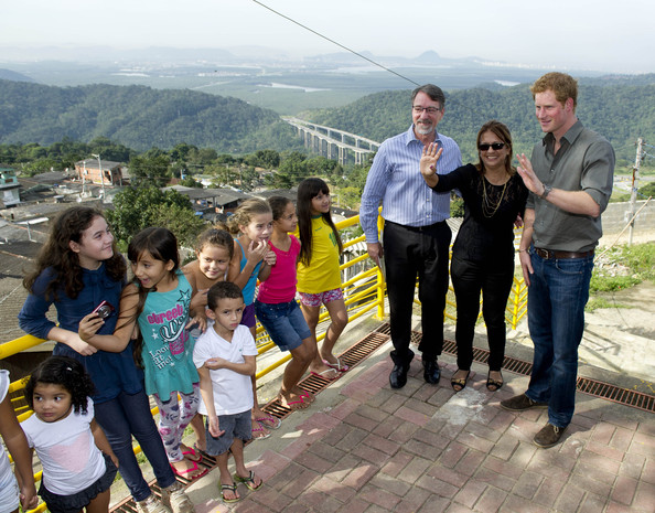 Prince Harry meets local children from a village during a trip to the Atlantic Rainforest on June 25, 2014 near Sao Paulo, Brazil. Prince Harry is on a four day tour of Brazil that will be followed by two days in Chile.