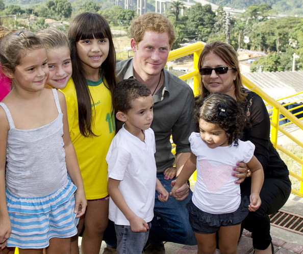 Prince Harry poses with local children from a village during a trip to the Atlantic Rainforest on June 25, 2014 near Sao Paulo, Brazil. Prince Harry is on a four day tour of Brazil that will be followed by two days in Chile.