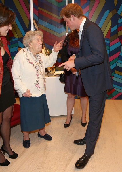 Prince Harry meets Sao Paulos oldest member of the British Community Gertrude Viger, aged 102, at a GREAT Britain reception on June 25, 2014 in Sao Paulo Brazil.  Prince Harry is on a four day tour of Brazil that will be followed by Two days in Chile.