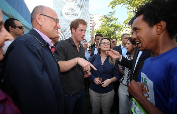 Prince Harry speaks to doctors and crack addicts as he visits the Open Arms project which helps reduce crime and drug abuse in 'Cracolandia', an extremely deprived area of Sao Paulo with a high concentration of crack addicts on June 26, 2014 in Sao Paulo Brazil. Crack in Sao Paulo costs just 80 UK pence for a rock of the drug. Prince Harry is on a four day tour of Brazil that will be followed by two days in Chile.