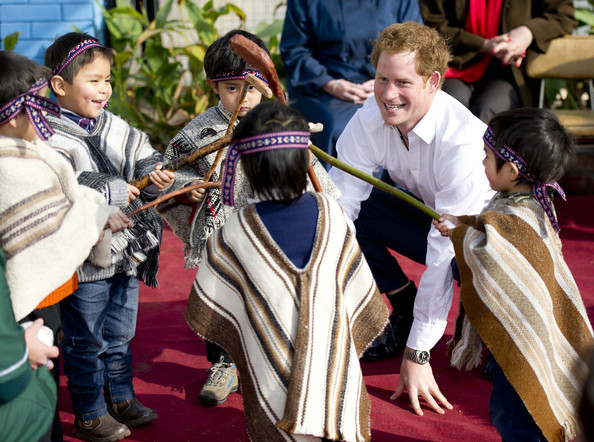 Prince Harry takes part in the kids games as he visits kindergarten of indigenous children a on June 27, 2014 in Santiago, Chile.  Prince Harry is on a three day tour of Chile after visiting Brazil.